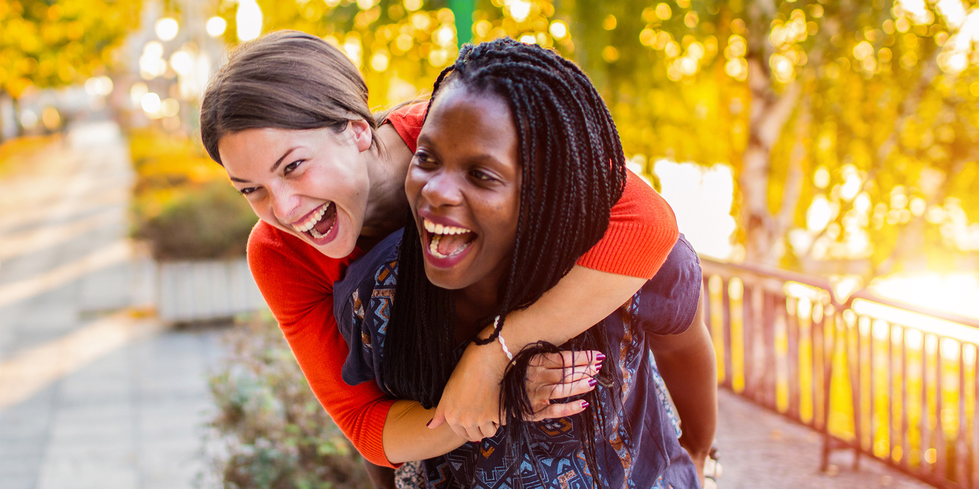 Two women laughing together